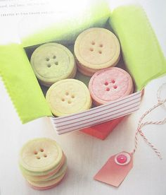 button sugar cookies- use a 1 3/4 in round cutter then lightly press a 1 1/2 cutter on top and use a skewer to make button holes...so cute!