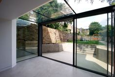 The versatile glass extension on this traditional home uses a glass roof & frameless structural glass sides which connect to our minimally framed sliding doors. Extension Veranda, Conservatory Extension, Glass Conservatory, House Extension Design, Extension Designs, Glass Extension, House Design, Modern Conservatory, Garden Room Extensions