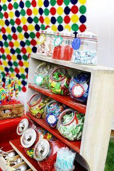 Cute candy shelf stand at a Sesame Street Elmo party via Kara's Party Ideas KarasPartyIdeas.com