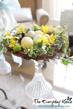 How to Craft a Bird Nest with Eggs: using a pre-made grapevine nest, some moss & eggs and bits of floral pieces you can create a gorgeous Spring bird nest.