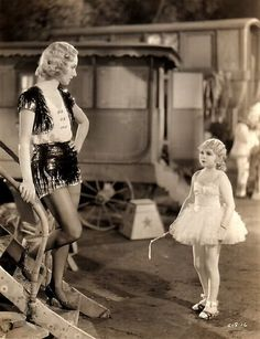 **Freaks (1932)  Wallace Ford, Leila Hyams, Olga Baclanova Director: Tod Browning - Beautiful trapeze artist cons one of the sideshow people into romance, just for his money.  Love, betrayal, jealousy at the circus sideshow.