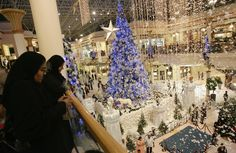 Emirati women look at Christmas decorations at one of Dubai's main shopping malls.   - ELLEDecor.com