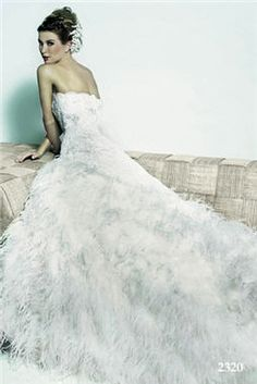 feather wedding dress IDEAS: Dress Ideas for Weddings. Wedding Directory-UK {WDUK} Wedding Dresses, Bridesmaid Dresses, Mother of the Bride Dresses Long Wedding Dresses, Wedding Dress Styles, Wedding Gowns, Wedding Dress With Feathers, Feather Dress, Wedding Bells, Wedding Bride, Dream Wedding, Bling Wedding