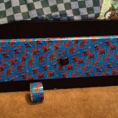Decorated my sons beds drawers with spiderman duck tape. It was so easy and cheap and now he has a themed bed. Find your kids favorite duck tape color or picture and go at there beds or dresser drawers have fun.