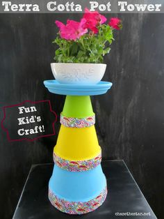 Terra Cotta Pot Tower- Had a blast with my son working on this fun Kid's Project!  via www.chasethestar.net #kidscraft, #plaid, #modpodge, #washitape #plaidkidscraft