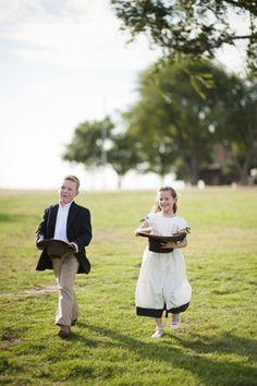 flower girl and ring bearer use cowboy hats - ranch wedding - Photo by Lauren Larsen