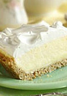 White Chocolate-Coconut Cream Pie — Melted white chocolate covers a coconut and graham cracker crust that is filled with coconut pudding and whipped cream for a cool and luscious pie.