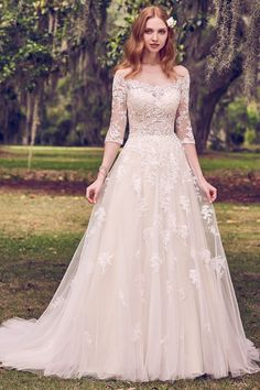 Aline Wedding Dresses maggie sottero 2018 gold dress (bree) off shoulder sleeves lace bodice aline wedding dress champagne color mv romantic -- A Gold Dress for a Glamorous Wedding? Wedding Dress Pictures, Rustic Wedding Dresses, Best Wedding Dresses, Designer Wedding Dresses, Beige Wedding Dress, Champagne Lace Wedding Dress, Cream Colored Wedding Dress, Lace Wedding Dress With Sleeves, Country Wedding Gowns