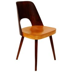Viennese Bicolored Chair in Beech by Oswald Haerdtl for Thonet, 1950s   From a unique collection of antique and modern dining room chairs at https://www.1stdibs.com/furniture/seating/dining-room-chairs/