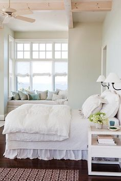 Like this bedroom - the bed looks very comfortable, like the little lamps next to the bed, and like the window seat.