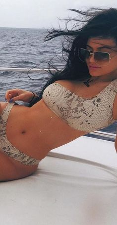 Who made Kylie Jenner's snake print sneakers and one shoulder bikini?