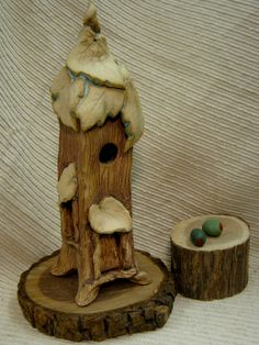 A personal favorite from my Etsy shop https://www.etsy.com/listing/116669573/clay-pottery-fairy-house-night-light