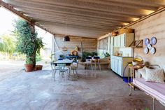 Polished concrete floor. Covered patio/outdoor dining area.