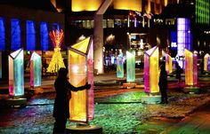 This dazzling public art installation in Montreal emits colorful lights from 50 prisms.
