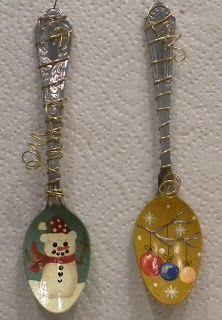 Wired Spoon Ornaments...  You could buy the fake silver plastic ones, paint, embellish , and put a hold thru the top and hang as tree ornament or garlands in the kitchen