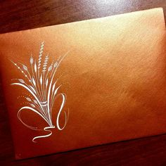 Flourished copper envelope by Kathy Milici Creative.