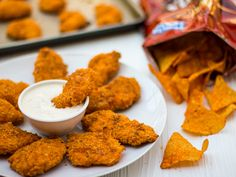 Oven baked chicken strips coated with crushed Doritos. Easy homemade chicken fingers that have the crunch and flavor of Doritos. Homemade Chicken Fingers, Chicken Finger Recipes, Chicken Nugget Recipes, Doritos Chicken, Chicken Tenders, Chicken Breasts, Baked Chicken Strips, Comidas Fitness, Chicken Nuggets