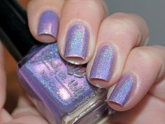 """""""Head over heels"""" is a 5 free hand-blended, custom nail polish. (Toluene, Formaldehyde, TSF resin, Camphor and DBP free)BASE - Light purple with a strong pink shimmer.GLITTER - N/AOPAQUE - in 2 coats depending on application.PHOTO SHOWS - Two coats of """"Head over heels"""" without a topcoat.Photos are indoors with and without flashBOTTLE AND INGREDIENTS DETAILS*12ml bottle* Easy to apply brush* Stainless steel ball bearings.* I only use a ..."""