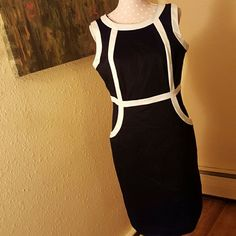 Black and White Dress Beautiful, classic dress. High cut in front withv in back. Zip closure. Sleeveless. Pockets. Fully lined. Perfect for office or dress occasion. Wear with heels or sweater and boots! Worthington Dresses Asymmetrical
