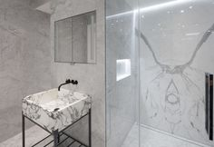 Bookmatch marble in home spa, freestanding cast marble washbasin on black metal stand. mirrored cupboards above. Architects London, Earls Court, Residential Architect, Home Spa, Cupboards, Black Metal, Bathrooms, Marble, New Homes