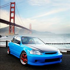 Blue Honda Civic Hatchback with Red Rims