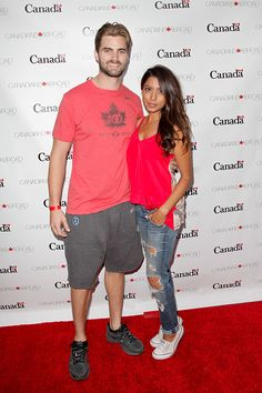 Mike Bradwell and Aliya Jasmine attend the Canada Day in LA party at on July 1 2015 in Santa Monica California