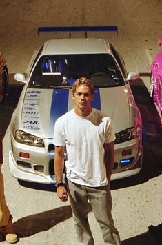paul walker skyline a shot of Paul Walker in front of his well known Famp;F 2 Nissan Skyline GTR Skyline Gtr R34, Nissan Skyline Gt R, Nissan Gt R, Fast And Furious, Audi Rs6, Bmw Isetta, Voiture Paul Walker, Paul Walker Car, Furious Movie
