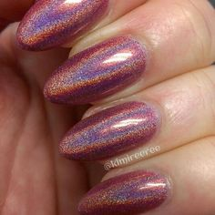 The Dusty Rose from Bear Pawlish. Not available from her site anymore except as a custom but even something really similar as a rosy holo would be amazing!