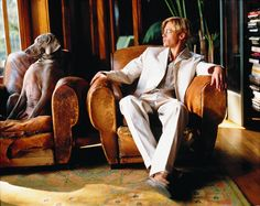 Brad Pitt posing with his Weimaraner, Purdy; by famed dog photographer William Wegman in the late 1990s.