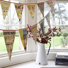 Bunting displayed in bay of window with jug of flowers. Bunting displayed in bay of window with jug of flowers. The post Bunting displayed in bay of window with jug of flowers. appeared first on Deco.