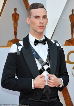 Shaking things up: Instead of a traditional tuxedo, Adam opted to wear a cold-shoulder jac...