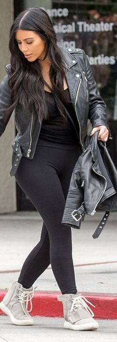 Who made  Kim Kardashian's gray handbag, black leather jacket, and sneakers?