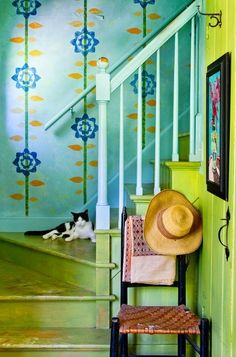 Love the wallpaper (or hand painted) back of stairway and especially with the citron green stairs.....