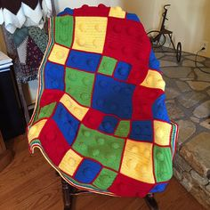 This blanket measures approximately 44 x 51, making it a great size for kids to curl up with while watching TV, reading, or just snuggling up. It resembles the popular Lego building blocks in the primary colors. The pegs are stuffed with fiberfill to give the 3-D effect.  The pictures show it in red, green, blue and yellow primary colors. There is also a pastel combination (purple, pink, gray, white) also available. It is constructed with 100% acrylic yarn, making it perfect for machine…