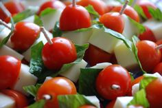 Super quick and easy party food.  Buy the fancy toothpicks..dont cheap out!  Cherry tomato, basil leaf, chunk of mozzarella.  Voila!  Looks beautiful, easy for guests, and fairly inexpensive.  Keep a bit of balsamic handy if you want to dip! Caprese Skewers!