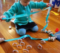 threading cut up toilet paper tubes on ribbon