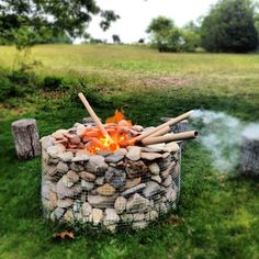 Gabion fire pit. Useful for planter walls as well. Gabion= wire mesh cage filled with small rocks & stones. handy way of turning stones from garden into a wall without mortar.