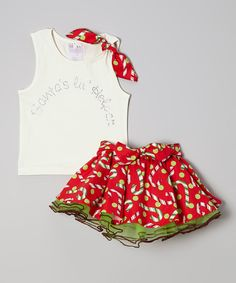 Shining brighter than the snow of the North Pole, this adorable tank features a sweet rhinestone embellishment and pretty bow on the shoulder. The matching skirt boasts a delicious print with tulle ruffles for added charm. Includes tank and skirt95% cotton / 5% spandexHand washImported