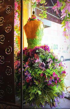 An adorable floral dress window display at La De Da, Roanoke, VA on Market Street at the corner~ Florist Window Display, Spring Window Display, Store Window Displays, Shop Displays, Deco Floral, Floral Design, Christmas Tree Dress, Flower Dresses, Flower Art