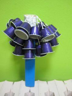 Construye instrumentos musicales con materiales reciclados