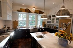 Kitchen island.  Farm sink.  Black cabinets.