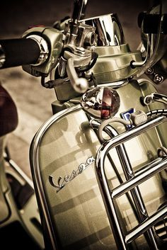 Vespa with vintage fittings and front luggage rack, in the right color....these luxury model Vespas (LVX 150..)are hard to find these days...but this was a keeper when it first became available (2009, I believe)..if you see a good one at the right price, you might want to pick it up..they're rather timeless...