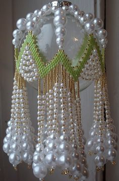 LIME RICKEY Beaded Ornament Cover E-Pattern by cathylikestocraft--The rickrack band is dripping with different sized pearls and is done in diagonal peyote stitch.Beaded Fancy Fringed Ornament Cover Beading,me rruza,pune dore,llampa me rruza, For some Beaded Ornament Covers, Beaded Christmas Ornaments, Handmade Christmas, Christmas Balls, Christmas Decor, Etsy Christmas, Beaded Crafts, Beading Projects, Bead Art
