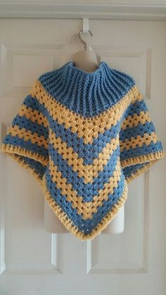 Hot Off My Hook! Project: Cowl-Neck Poncho Started: 29 Oct 2015  Completed:  01 Nov 2015 Model: Madge the Mannequin Crochet Hook(s): 7mm, Cowl portion J, Granny Stitch Yarn: Redheart With Love, Redheart Super Saver Color(s): Bluebell, Cornmeal Pattern Source: Simply Crochet Magazine Issue No. 25 Pattern Designed By: Simone Francis Notes: This is my 43rd Cowl-Neck Poncho!