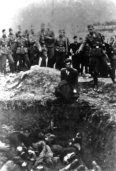 "The man looks directly at the photographer, an Einsatzgruppen soldier, the moment before he is shot; below him are his dead friends, neighbours and family. The soldier wrote on the back of this photo ""the last Jew in Vinnitsa, 1941."" (km) From The Ten Most Iconic Photos Of The 1940s"