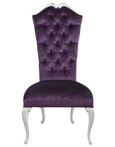 One would feel like royalty if this purple tufted chair occupied a corner of a boudoir or were one of several in a formal dining room. (purple, decor)