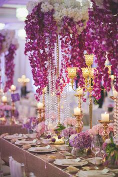 Suspended purple orchids and crystals with gold candles and sparkly tablecloth // Purple Splendour: Jwin and Pei Lu's Wedding at The Majestic Hotel