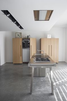 bulthaup kitchen-good example of spacing for multi-sided cooktop and sink