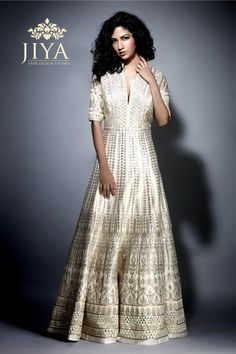 A stunning pearl and gold gota patti & mirror work gown for the  contemporary Indian bride. Subtle elegance like no other.