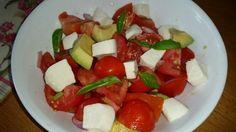 Homegrown Mormino Jersey tomatoes, avocado, red onion and fresh mozzarella salad